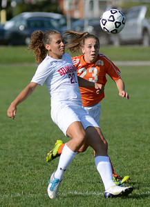 Selinsgrove's Madison Weirick keeps the ball ahead of Danville's Kiersten Zerbe during their game Thursday Sept. 6, 2012 in Selinsgrove.