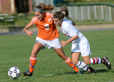Danville's Brittany Walters and Selinsgrove's Alli Cover battle for control of the ball during their game Thursday Sept. 6, 2012.
