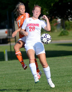 Danville's Paige Harris and Selinsgrove's Mackenzie Herman face off for a free ball during their game Thursday Sept. 6, 2012 in Selinsgrove.