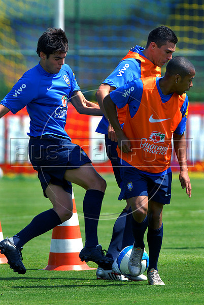 Brazil's striker Robinho, right, fights for the ball with teammates Kaka, left and Lucio, center, during a practice in Teresopolis, 100 Km from Rio de Janeiro, Brazil, Nov. 14, 2007. Brazil's team trains for its FIFA WC South Africa 2010 qualifier with Peru next 18 November. (Austral Foto/Renzo Gostoli)