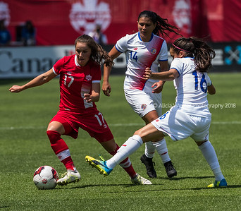 Toronto, Ontario (June 11, 2017) - Canada's Midfielder Jessie Fleming (17) defence the ball against Midfielder Katherine Alvarado (16) during their friendly match for Canada's 150th birthday in Toronto, Ont. Sunday evening.  Canada beat Costa Rica 6-0.  Photo by Alicia Wynter