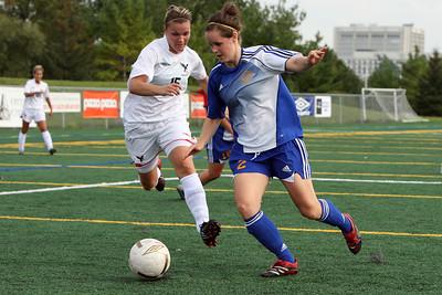 Gabrielle Charbonneau attacks Ryerson's Meagan Blodgett.