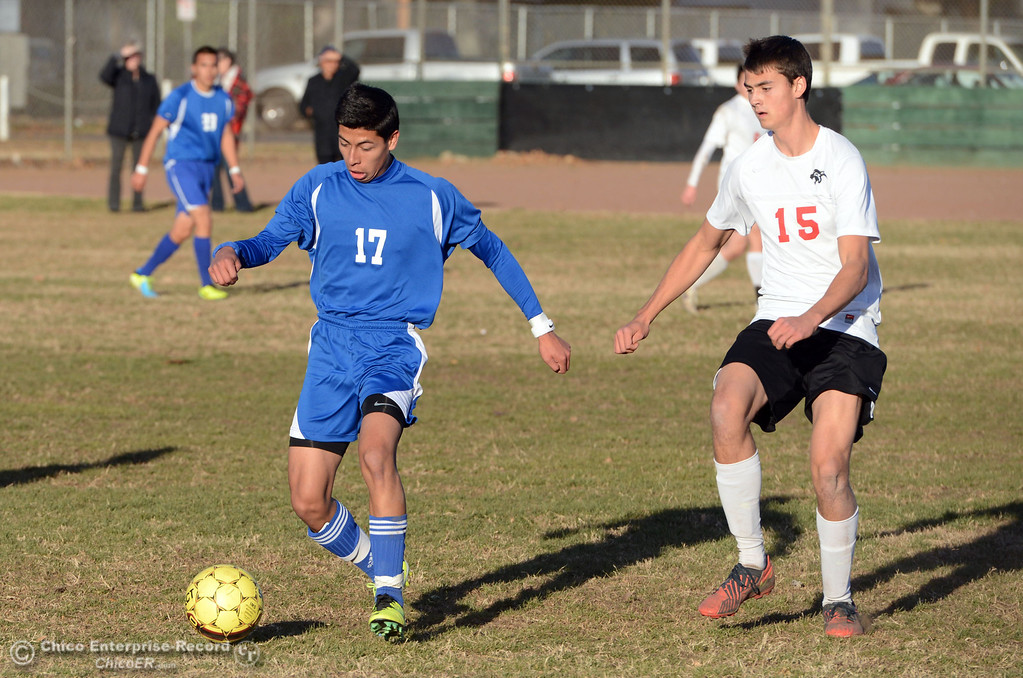 . Orland High\'s #17 Francisco Guerrero (right) against Chico High\'s #17 Omar Carey (left) in the first half of their boys soccer game at CHS Thursday, December 19, 2013 in Chico, Calif. (Jason Halley/Chico Enterprise-Record)