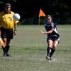 Krista Dukes takes a corner kick