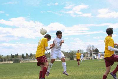 Gering's James Guzman heads a shot into goal in the first half to tie the score 1-1 in the match against Laramie, Wyo., on Saturday at the Landers Soccer Complex.