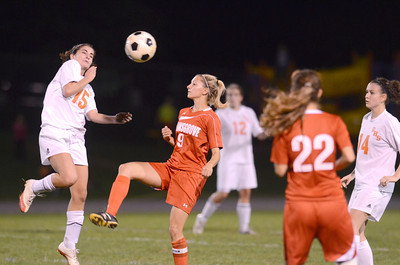 Danville's Sarah Naessig and Selinsgrove's Jenna Fisher go for the ball during Monday's game.
