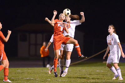 Selinsgrove's Jenna Fisher and Danville's Siobahn bross compete for the head ball during Monday's game in Danville.