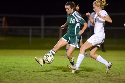 Lewisburg's Lauren Gargano passes the ball away from Midd-West's Miranda Heeter during Wednesday's game.