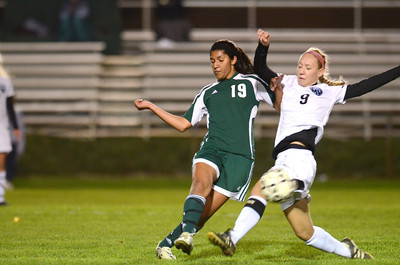 Lewisburg's Nicole Bhangdia knocks the ball away from Midd-West's Allie Camp during Wednesday's game.