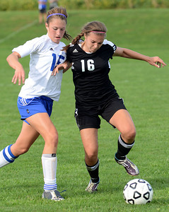 Warrior Run's Taylor Landis and Southern Columbia's Lauren Kerstetter battle for the ball during their game Tuesday Sept. 11, 2012.