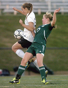 Athens's Morgan Westbrook and Lewisburg's Elke Velz collide during Tuesday's playoff game at the Loyalsock High School.