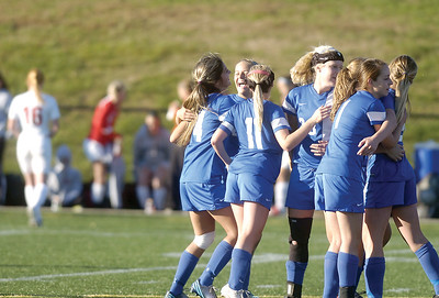 The Warrior Run girls soccer team celebrates after Tuesday's win against Selinsgrove during the D4 soccer playoffs at the Loyalsock High School.