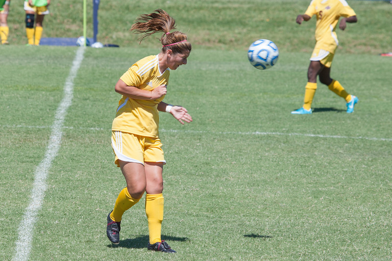 Katy Catney heads the ball.