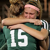 Grace Kiernan hugs teammate Sarah Duhaime (15) as the season ends.