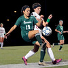Taylor Rodriguez gets a foot on the ball in front of Central Catholic's Brooke Hernon.