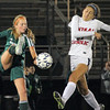 Central Catholic's Daria Bakhtiari protects herself from a kick by Nashoba's Jayne Conry.