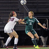 Central Catholic's Sarah Berube and Nashoba's Addison Jaromin keep their eyes on the floating ball.