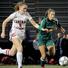 Nashoba's Alana Carlucci tries to beat Central Catholic's Erin Kinsella to the ball.