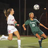 Lillian Hammill sets up to boot the ball away from Central Catholic's Caitlin Regan.