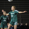 Nashoba's Ashlyn MacLure directs a head ball downfield.