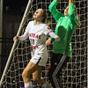 Nashoba's Theresa Don makes a save over the head of Caitlin Regan of Central Catholic.