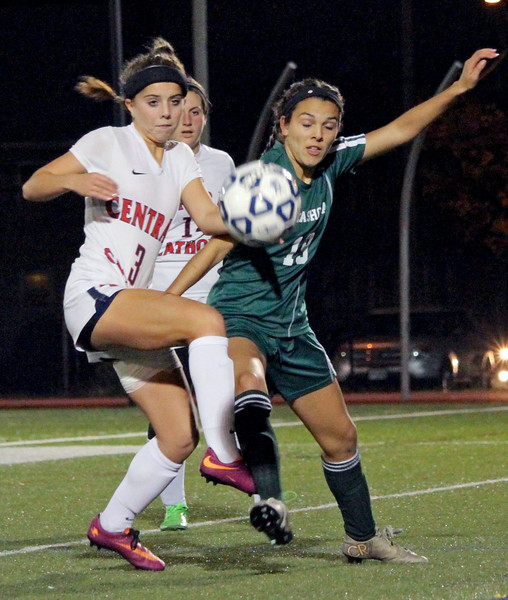 Central Catholic's Brooke Hernon and Nashoba's Taylor Rodriguez battle along the sideline.