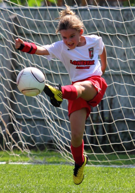 IMAGE: http://waterrockets.smugmug.com/Sports/Soccer/Paraguay-Soccer-Mar-31-2012/i-8grH5bN/0/XL/IMG8060-XL.jpg