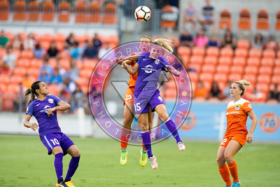 Amber Brooks #12 M and Rachel Hill #15 F battle for the air ball first half Houston Dash vs Orlando Pride  BBVA Compass Stadium Houston, Texas June 17, 2017