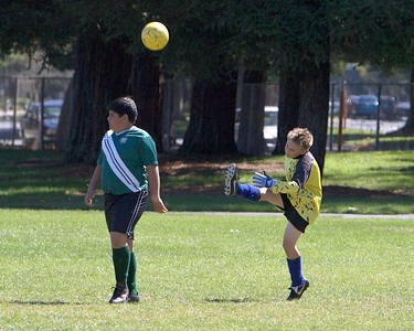 Miles sends the ball to the other end of the field.