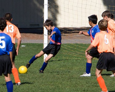 Adam clears the ball, once again denying the Tigers their prey.