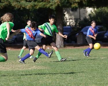 Kick it up the field.
