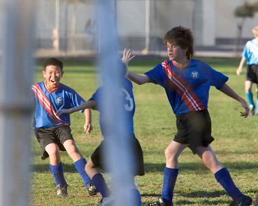 Jeffrey, Julian, and Kevin celebrate our first goal.