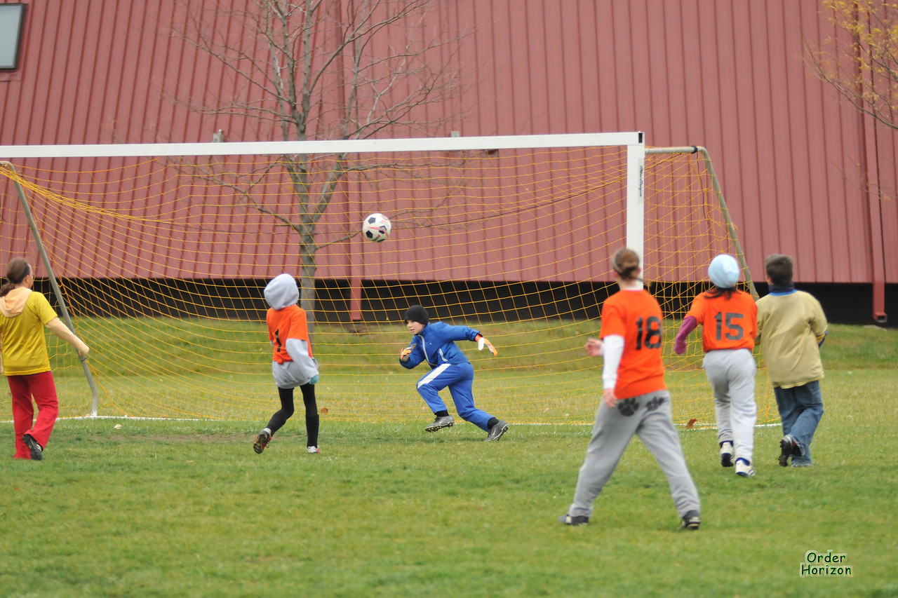 One of several close shaves. The goalie doesn't stop the ball but it falls outside the far goal post. One gust of wind and it would have been different.
