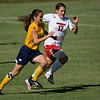 Ashton Morris (10) and Kerry Pivovar (17) chase after the ball.