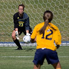 Lauren Fox makes a save from a shot by Sherri Collins (12).