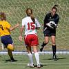 Lauren Fox makes a save as Kate Foran (7) crashes the goal.