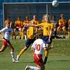 Kate Foran leaps to head the ball.