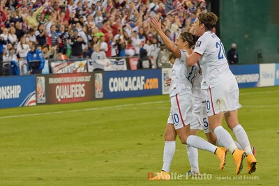 The ladies celebrate a goal.