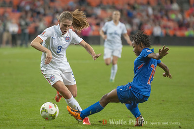 Clorene Rateau (19) tackles the ball from Heather O'Reilly (9)