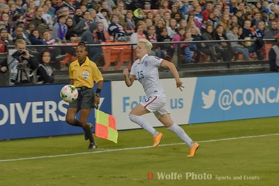 Megan Rapinoe  (15) chases down a sideline ball