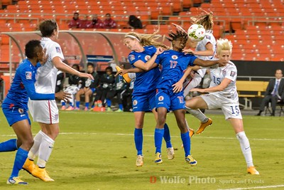 Major pile up as the fight for the header ensues on a corner kick
