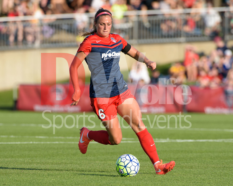 Spirit defender Shelina Zadorsky turns the ball stopping a Pride attack.
