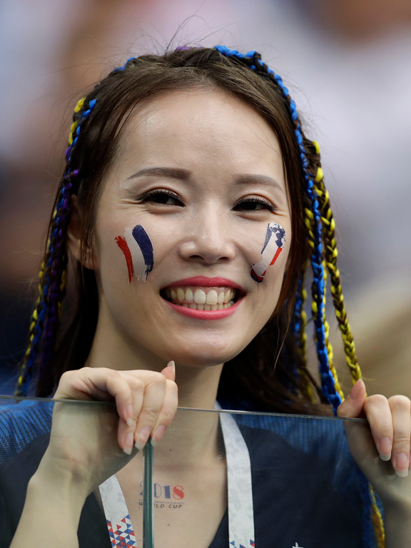 . A France fan waits in the stands for the start of the quarterfinal match between Uruguay and France at the 2018 soccer World Cup in the Nizhny Novgorod Stadium, in Nizhny Novgorod, Russia, Friday, July 6, 2018. (AP Photo/Natacha Pisarenko)