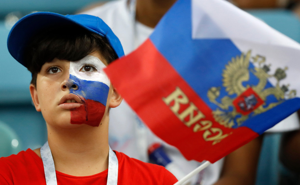 . A young Russian fan looks on prior the quarterfinal match between Russia and Croatia at the 2018 soccer World Cup in the Fisht Stadium, in Sochi, Russia, Saturday, July 7, 2018. (AP Photo/Darko Bandic)
