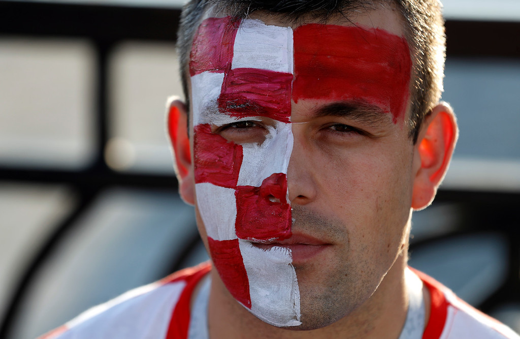 . A fan with Croatian flag painted on his face waits for the quarterfinal match between Russia and Croatia at the 2018 soccer World Cup in the Fisht Stadium, in Sochi, Russia, Saturday, July 7, 2018. (AP Photo/Rebecca Blackwell)