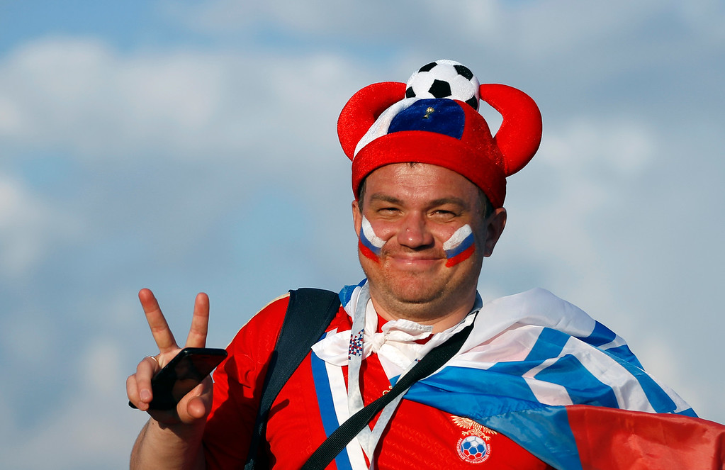 . A fan with Russian flags painted on his face waits for the quarterfinal match between Russia and Croatia at the 2018 soccer World Cup in the Fisht Stadium, in Sochi, Russia, Saturday, July 7, 2018. (AP Photo/Rebecca Blackwell)