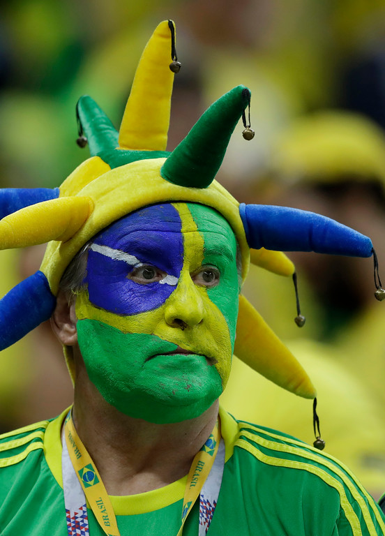 . A Brazil fan sits dejectedly in the stands after Brazil was knocked out with a 2-1 defeat by Belgium in their quarterfinal match at the 2018 soccer World Cup in the Kazan Arena, in Kazan, Russia, Friday, July 6, 2018. (AP Photo/Andre Penner)