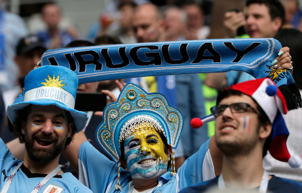 . Fans wait for the start of the quarterfinal match between Uruguay and France at the 2018 soccer World Cup in the Nizhny Novgorod Stadium, in Nizhny Novgorod, Russia, Friday, July 6, 2018. (AP Photo/Ricardo Mazalan)