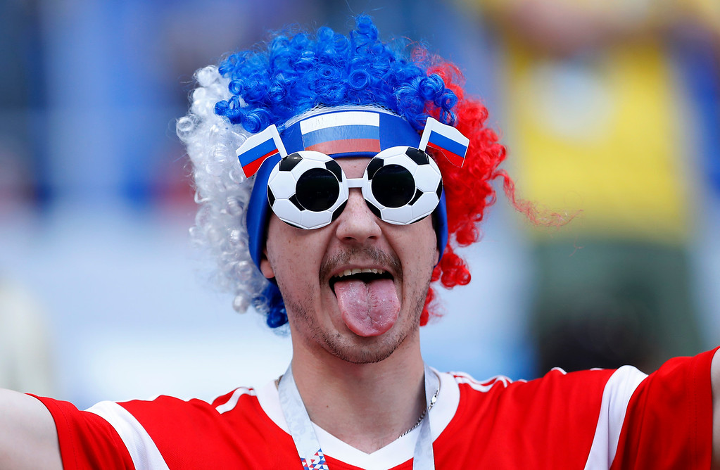 . A fan waits the quarterfinal match between Sweden and England at the 2018 soccer World Cup in the Samara Arena, in Samara, Russia, Saturday, July 7, 2018. (AP Photo/Alastair Grant)