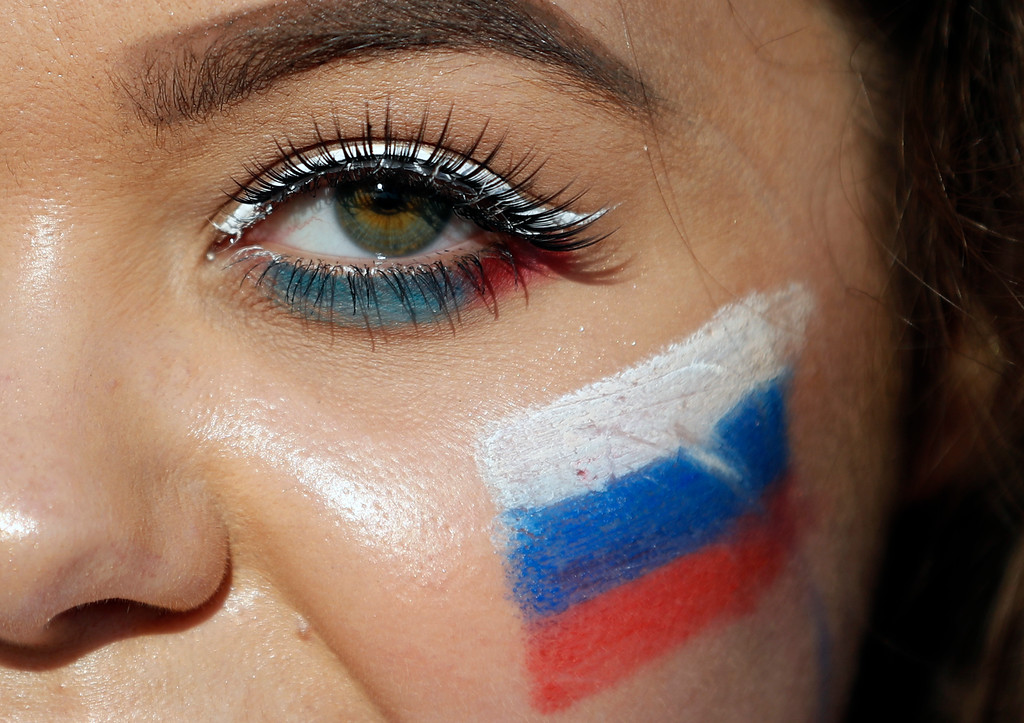 . A fan with Russian flag painted on her face waits for the quarterfinal match between Russia and Croatia at the 2018 soccer World Cup in the Fisht Stadium, in Sochi, Russia, Saturday, July 7, 2018. (AP Photo/Rebecca Blackwell)